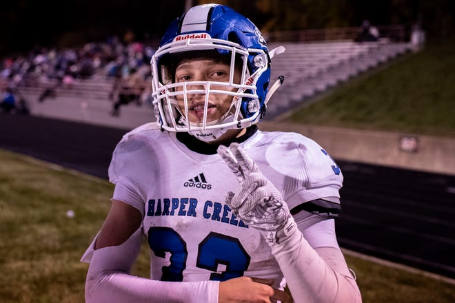 Harper Creek junior Julion McCray (33) poses for the camera on Friday, Oct. 16, 2020 at Marshall High School in Marshall, Mich.