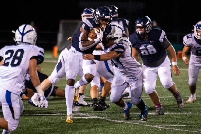 St. Augustine's Kanye Udoh (6) rushes against Hammonton Friday, Oct. 16, 2020 in Buena Vista Township, N.J. St. Augustine won 20-7.