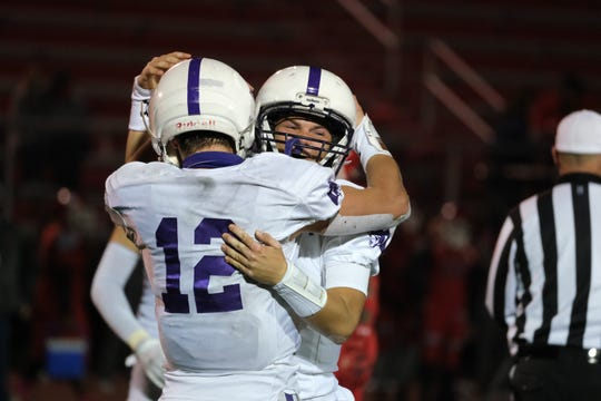 Elder's Ben Hambleton (6) and Drew Ramsey (12) celebrate after winning a playoff game with the Princeton Vikings at Princeton High School Friday, Oct. 16, 2020. Elder defeated Princeton 26-21 to advance to the next round of the playoffs.