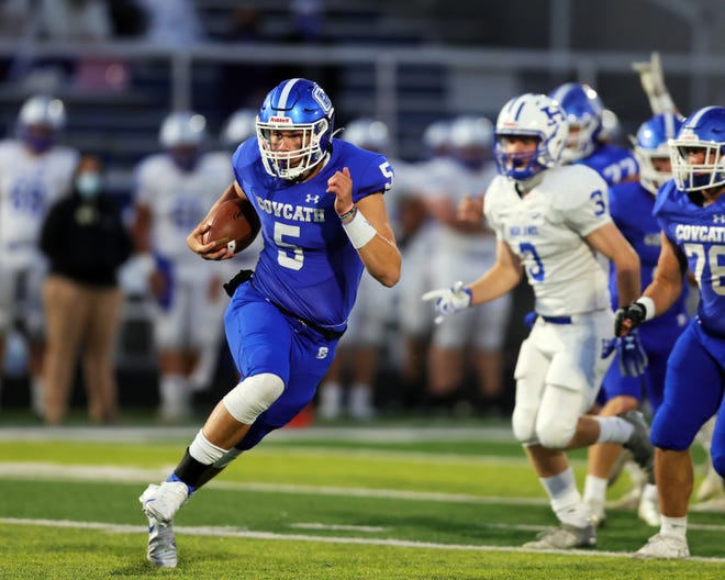 Covington Catholic quarterback Caleb Jacob runs for a first down in the game between Highlands and Covington Catholic high schools Oct. 16, 2020