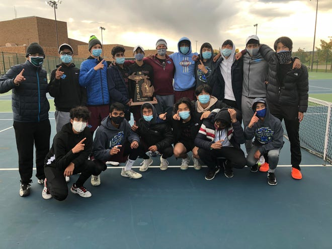 Okemos boys tennis team after winning the state championship in Division 1, Friday, Oct. 16, 2020.