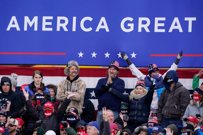 Supporters of President Donald Trump cheer as he speaks at a campaign rally, Saturday, Oct. 17, 2020, in Norton Shores.