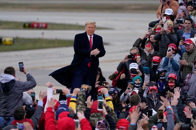 President Donald Trump arrives at a campaign rally, Saturday, Oct. 17, 2020, in Norton Shores.