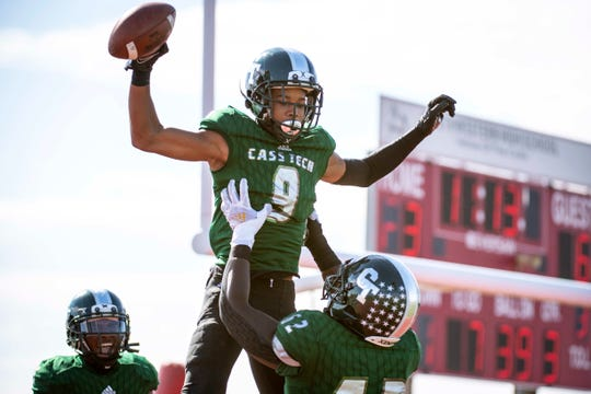 Cass Tech senior Raheem Anderson II (62) hoists junior Jameel Gardner (9) in the air after running a touchdown during the Detroit PSL Championship football game between Cass Tech and Detroit King at Detroit Northwestern High School in Detroit, Mich on Oct. 17, 2020. Cass Tech won, 41-19. (Nic Antaya, Special to The Detroit News)