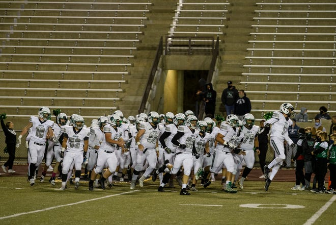 The North Huskies run onto the field before the game against the Central Bears at Central Stadium in Evansville, Ind., Friday, Oct. 16, 2020. The Huskies lost to the Bears 35-0 to finish with a 5-4 regular season record.