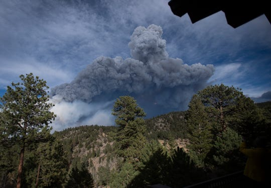 A column of smoke rises from the Cameron Peak Fire, the largest wildfire in Colorado history, as it burns outside Estes Park, Colo. on Friday, Oct. 16, 2020.