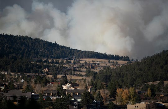 Smoke from the Cameron Peak Fire fills the sky outside Estes Park, Colo. on Friday, Oct. 16, 2020.