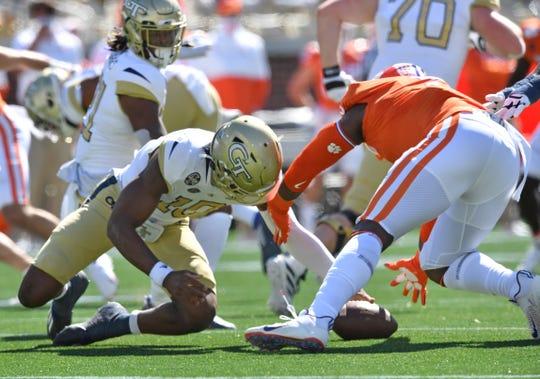 Clemson defensive end K.J. Henry recovers a fumble by Georgia Tech quarterback Jeff Sims.