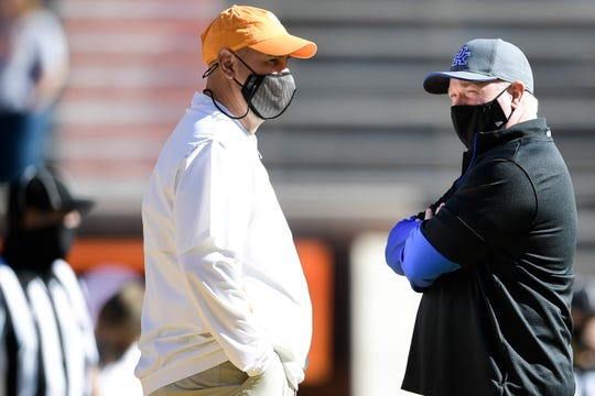 Tennessee Head Coach Jeremy Pruitt and Kentucky Head Coach Mark Stoops chat before a game between Tennessee and Kentucky at Neyland Stadium in Knoxville, Tenn. on Saturday, Oct. 17, 2020.
