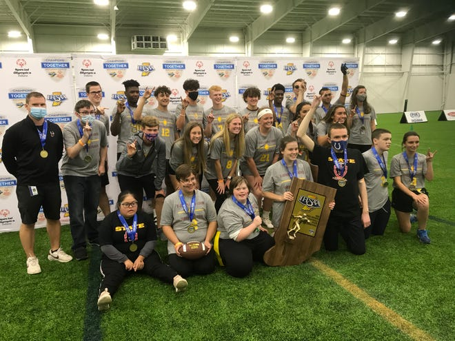 McCutcheon celebrates winning the IHSAA Unified Flag Football Championship on Saturday at Westfield's Grand Park. The Mavericks beat Fort Wayne Carroll 44-34