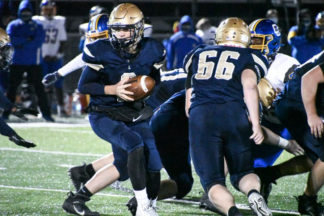 Lancaster sophomore quarterback Trace Van Gundy prepares to hand the ball off Friday night against visiting Gahanna.
