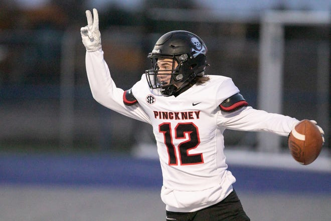 Lucas Pasternak of Pinckney celebrates after recovering a Lincoln fumble and running it in for the Pirates' first touchdown of the night in the first quarter of the game against Ypsilanti Lincoln Friday, Oct. 16, 2020.