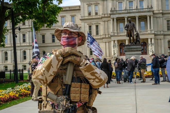 """The group called the Boogaloo Bois hold a rally at the state Capitol in Lansing Saturday, Oct. 17, 2020. According to spokespeople and literature at the rally, the movement wants the """"abolition of the overpowered, overreaching, tyrannical government."""""""