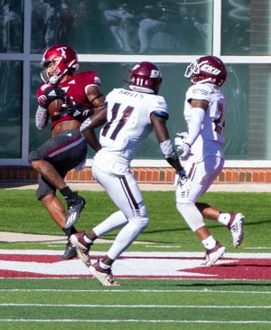 Troy University wide receiver Khalil McClain (6) snags a pass to the end zone for a Trojan touchdown.