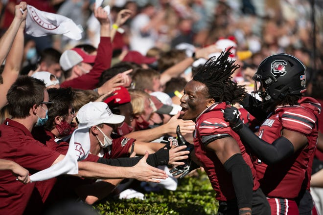 South Carolina defensive back Jaycee Horn celebrates with students after defeating Auburn in 2020.