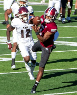 Troy University wide receiver Kaylon Geiger (1) bobbles but successfully grasps onto a pass putting the Trojans in touchdown territory.