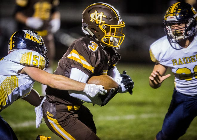 FILE -- Shenandoah's Dylan Ayres (No. 5) makes a tackle during a game against Monroe Central at Monroe Central High School Friday, Oct. 16, 2020.
