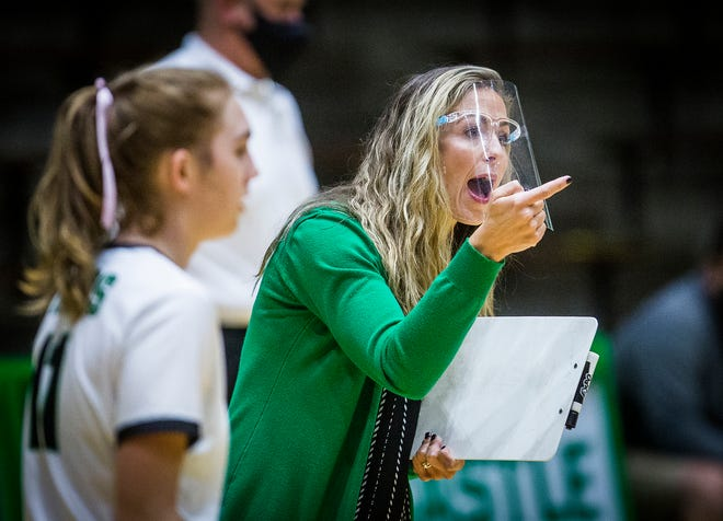Yorktown volleyball coach Stephanie Bloom leads the Tigers during their match against New Castle at New Castle High School Saturday, Oct. 17, 2020.