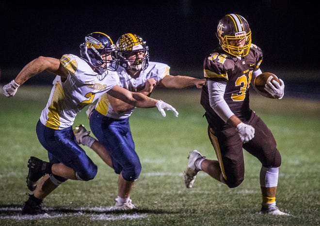 FILE -- Monroe Central's Joel Kennedy runs the ball against Shenandoah's defense during their game at Monroe Central High School Friday, Oct. 16, 2020.