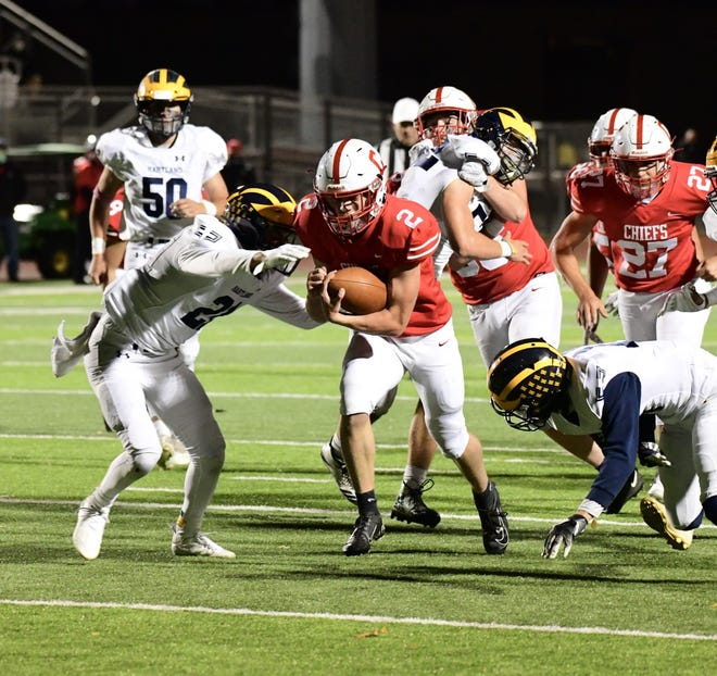 Canton junior Zack Badger finds a hole during his three-touchdown night against Hartland.