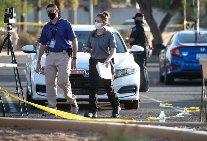 Mesa police investigate a multiple shooting on Oct. 17, 2020, in a parking lot near Dobson and Guadalupe roads in Mesa. At least seven people were shot during an incident the evening before.
