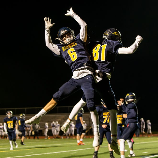 Greencastle's Adam Root (81) and teammate Levi Bingaman (6) celebrate Root's touchdown at Kaley Filed in Greencastle on Oct. 16, 2020.