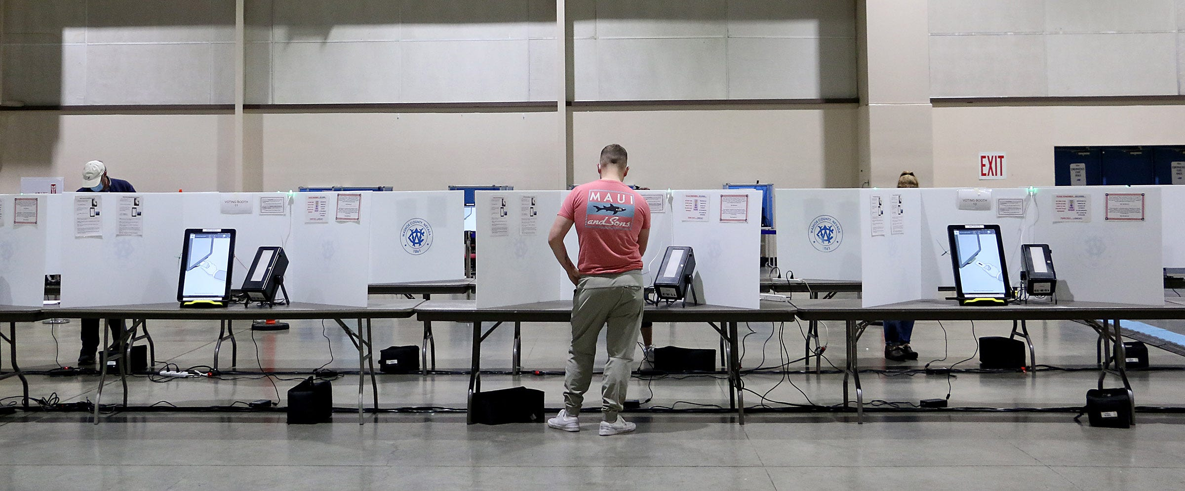 People participate in early voting at the Reno-Sparks Convention Center on Oct. 17, 2020.