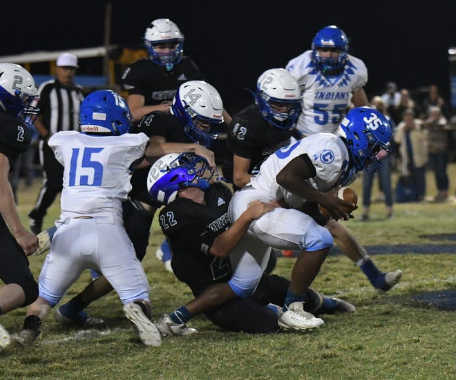 Cherokee High School's Eric Miller (35) fights for extra yardage while Richland Springs defender Landon Burkhart (22) attempts the tackle in a District 16-1A Division II game Friday, Oct. 16, 2020, in Richland Springs.