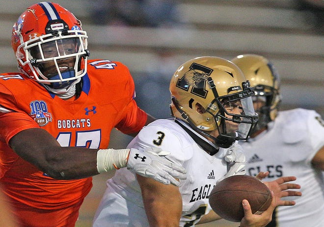 Monte'Vious Dobbins, far left, makes a tackle for Central during a game against Abilene in San Angelo on Friday, Oct. 16, 2020.