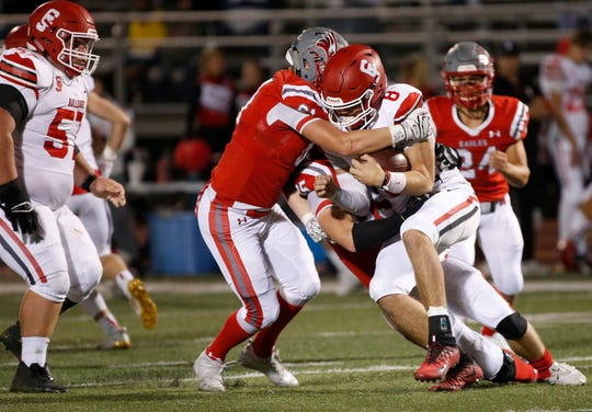 Dylan Nelson (61) and Corbin Speaks (85), of Nixa, sack Alex Baker during the Eagles 49-0 win over Carl Junction at Nixa High School on Friday, Oct. 26, 2020.