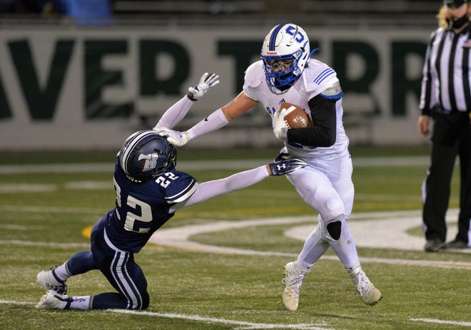 Sartell running back Ethan Torgrimson stiff arms the Bemidji player as he gets around the corner for a gain. Sartell lost 48-6 to Bemidji on Friday, October 16, 2020, at Bemidji State University.