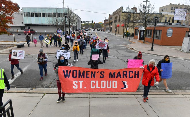Marchers approach the steps of the Stearns County Courthouse during the St. Cloud Women's March Saturday, Oct. 17, 2020, in downtown St. Cloud.
