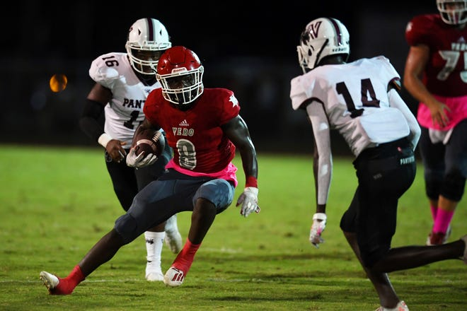 Vero Beach High School's Bobby McMillian cuts his way through the Fort Pierce Westwood defense en route to the first touchdown of the game on Friday, Oct. 16, 2020, at the Citrus Bowl. Vero Beach won the game 49-12.