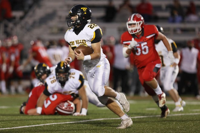 Tri-Valley's Blake Sands carries the ball against Jackson. Sands made first team in Division III.