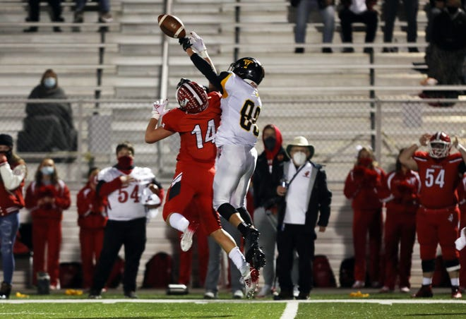 Tri-Valley's Alex Williams bats away a pass intended for Jackson receiver Tristan Prater in the final minute of Friday's game. Tri-Valley's Aidan Fritter caught the ball for an interception to seal the Scotties' win.