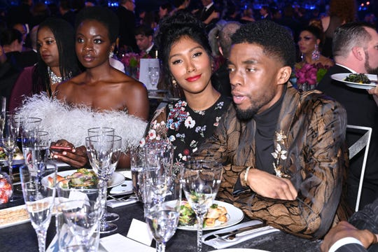 Chadwick Boseman, right, and Taylor Simone Ledward attended the 25th annual Screen Actors Guild Awards in Los Angeles in 2019. Boseman's 'Black Panther' co-star, Danai Gurira, left, sits with them.