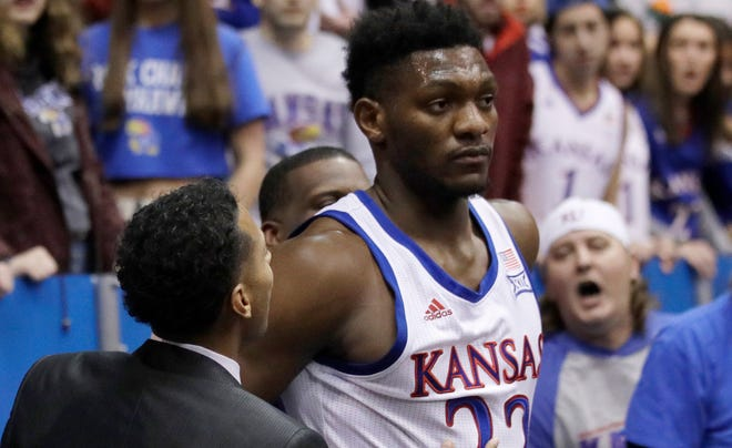 Kansas forward Silvio de Sousa walks out of the crowd after a brawl during the second half of a January game against Kansas State