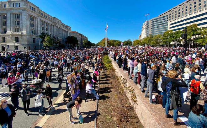 Women protesters gather for the Nationwide Women's March on October 17, 2020, at Freedom Plaza in Washington, DC.