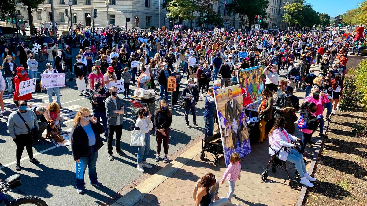 Women's March demonstrators gather to protest nomination of Amy Coney Barrett in Washington DC