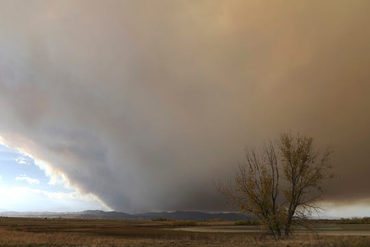 Smoke from the Cameron Peak Fire covers Fort Collins area sky at on Wednesday, Oct. 14, 2020. One of two Rocky Mountain wildfires fanned by strong winds has become the largest in Colorado history.
