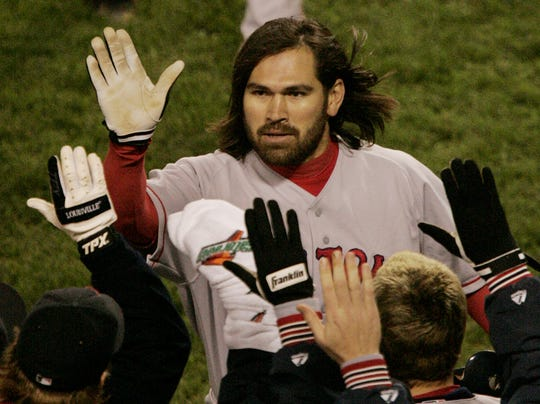 Boston's Johnny Damon celebrates his two-run home run against the New York Yankees in Game 7 of the American League Championship Series.