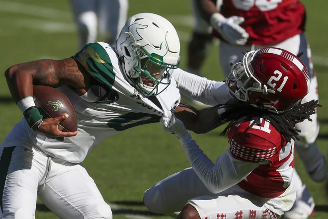 South Florida quarterback Noah Johnson (0) is brought down by Temple cornerback Freddie Johnson (21) in the second half at Lincoln Financial Field.
