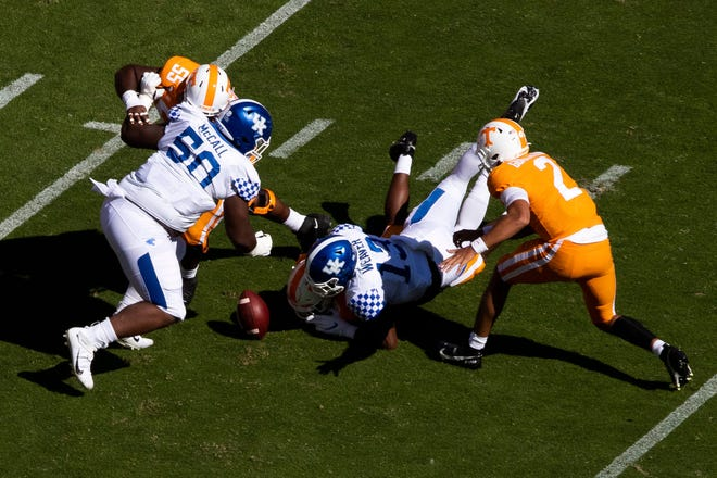 Tennessee quarterback Jarrett Guarantano (2) watches as his fumble is picked up by Kentucky during the first half at Neyland Stadium.
