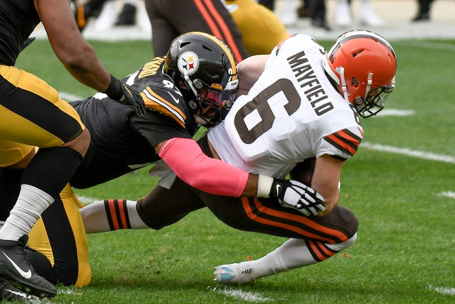 Cleveland Browns quarterback Baker Mayfield (6) is tackled by Pittsburgh Steelers defensive end Cameron Heyward (97) on a scramble during the first half of an NFL football game, Sunday, Oct. 18, 2020, in Pittsburgh. (AP Photo/Don Wright)