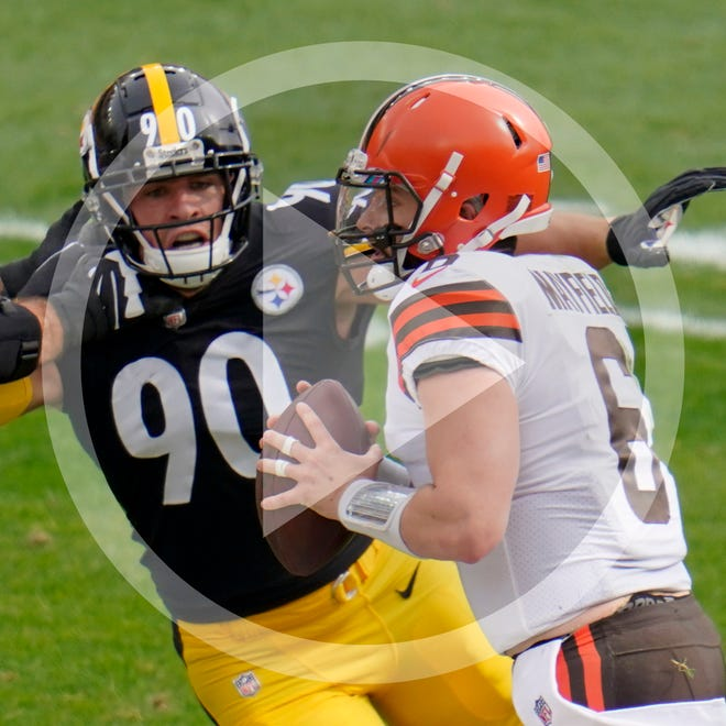 Pittsburgh Steelers outside linebacker T.J. Watt (90) pressures Cleveland Browns quarterback Baker Mayfield (6) as he looks to pass during the first half of an NFL football game, Sunday, Oct. 18, 2020, in Pittsburgh. (AP Photo/Gene J. Puskar)