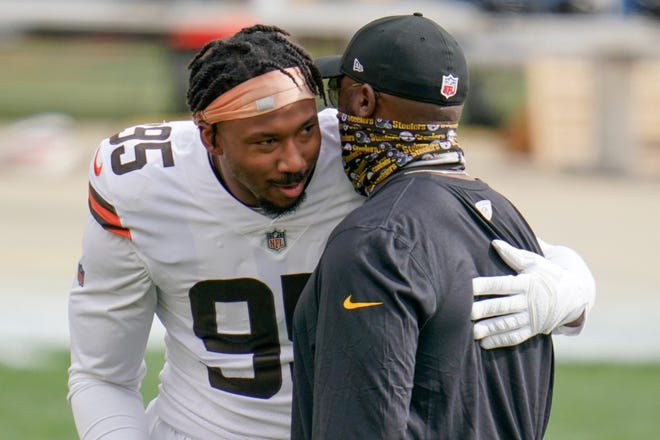 Browns defensive end Myles Garrett talks with Steelers coach Mike Tomlin before Sunday's game in Pittsburgh.