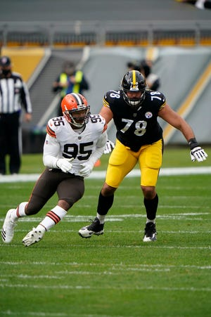 Cleveland Browns defensive end Myles Garrett (95) in action against Pittsburgh Steelers offensive tackle Alejandro Villanueva (78) during an NFL football game, Sunday, Oct. 18, 2020, in Pittsburgh. (AP Photo/Justin Berl)