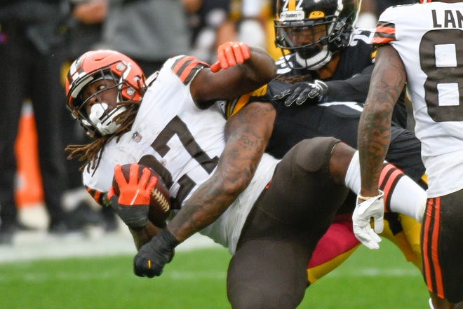 Cleveland Browns running back Kareem Hunt (27) is hit by Pittsburgh Steelers outside linebacker Bud Dupree (48) during the second half of an NFL football game, Sunday, Oct. 18, 2020, in Pittsburgh. (AP Photo/Don Wright)