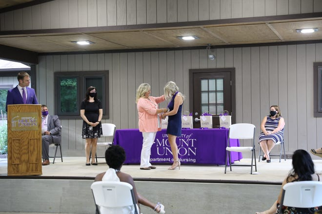Alyssa Hatton of Alliance is recognized Aug. 21 as part of Mount Union's second-degree accelerated BSNpinningceremony.
