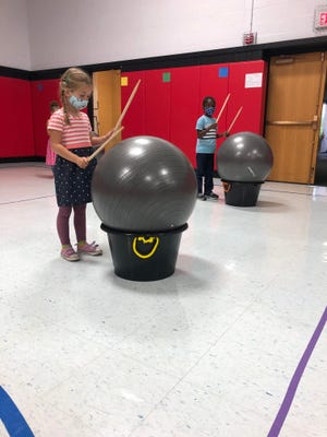 Students at in Matt Tafe's physical education class recently learned to move to a rhythm while drumming on an exercise ball.